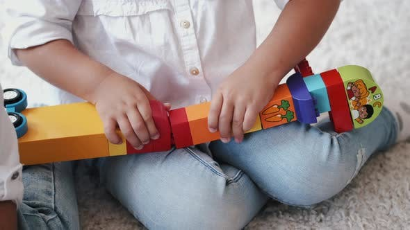 Thumbnail for Cropped View of Designing Construction From Colorful Bricks at Home