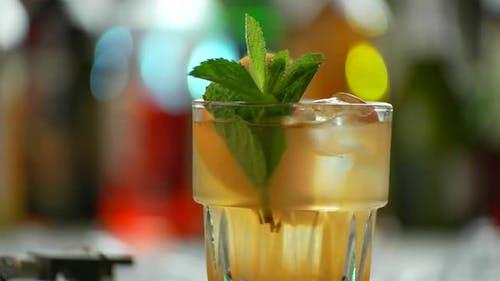 Glass of Orange Cocktail Rotates