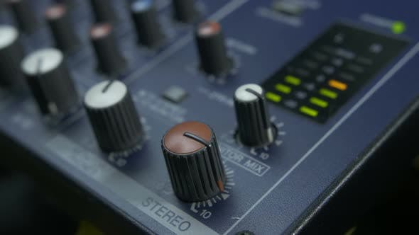 Thumbnail for Male Fingers Turning Fader Knob on Audio Mixer