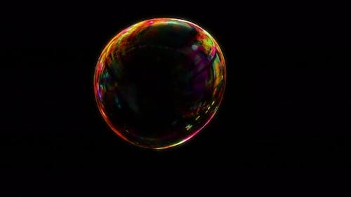 Red Soap Bubble Over Dark Black Screen Seamless Loop with Alpha Matte