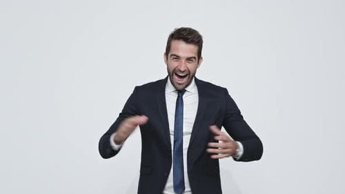 Enthusiastic Businessman Clapping