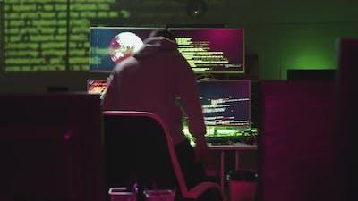 Criminal Hacker In Dark Office