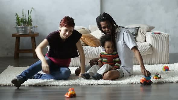 Thumbnail for Happy Interracial Family Playing with Car Toys