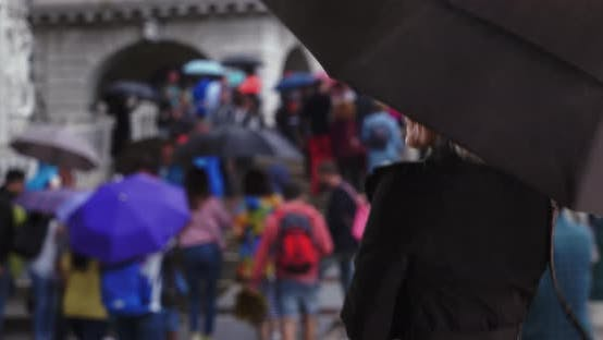 Thumbnail for Happy free spirited senior woman dancing in the rain with umbrella in Venice