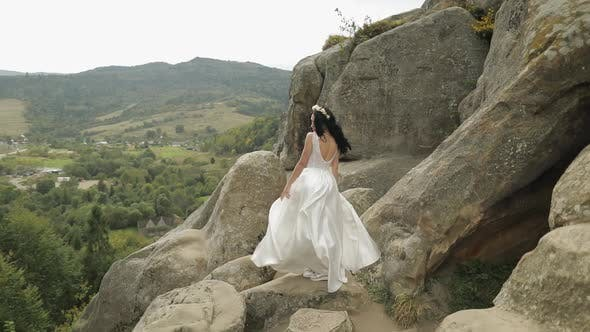Thumbnail for Beautiful and Lovely Bride Standing on the Mountain Hills. Woman in Love