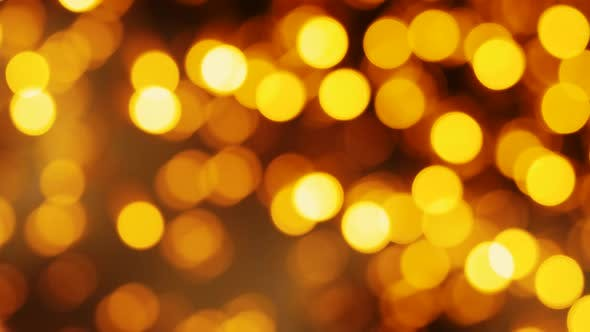 Thumbnail for Blurred Golden Christmas Lights Bokeh Background. Party Illumination