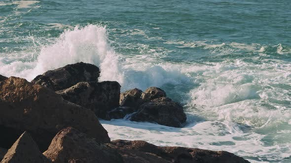 Ocean waves breaking over dangerous rocks in the Atlantic Ocean.