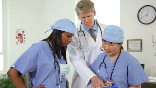 Portrait of three health care professionals