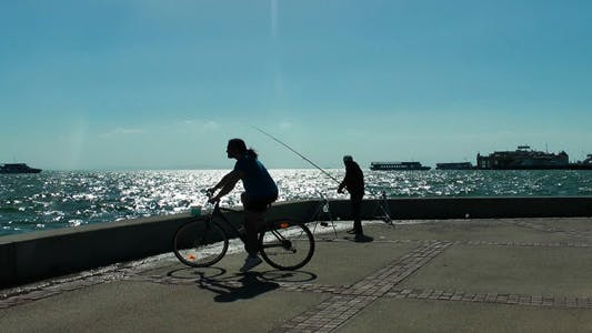 Thumbnail for Fisherman And A Man With A Bicycle