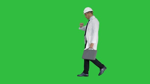 Thumbnail for Engineer walking in a rush and looking at his watch on