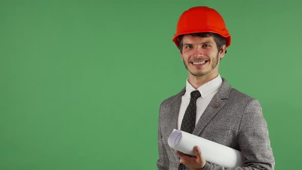Thumbnail for Cheerful Handsome Engineer Holding Copy Space on His Hand