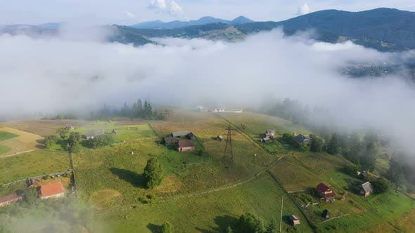 Cover Image for Morning Mountain Village Covered With The Clouds