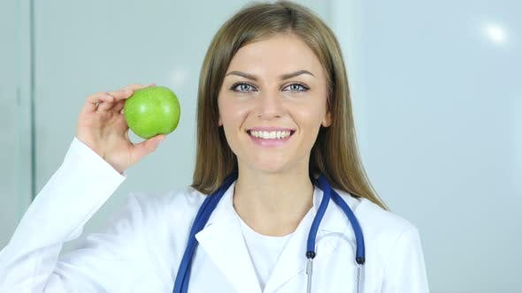 Thumbnail for Close Up of Female Doctor Holding Green Apple in Hand