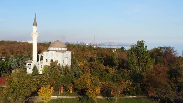 Thumbnail for The building of a mosque among autumn trees