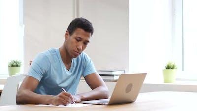 Black Man Writing on Paper, Paperwork