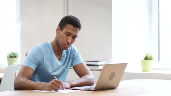 Cover Image for Black Man Writing on Paper, Paperwork