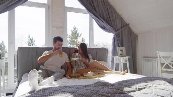 Thumbnail for Couple Enjoying Breakfast in Bed