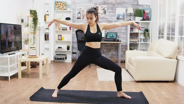 Thumbnail for Calm Young Female Practicing Yoga Exercises in Living Room