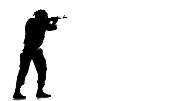 Thumbnail for Man Dressed in Camouflage Clothes. Silhouette