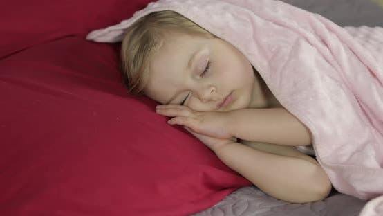 Thumbnail for Cute Baby Sleeping on the Bed at Home. Little Girl Sleeping in Morning Light