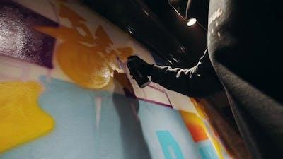 Young Urban Painter Drawing Graffiti on Wall