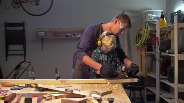 Thumbnail for Master Teaches Little Boy To Polish Wood Board