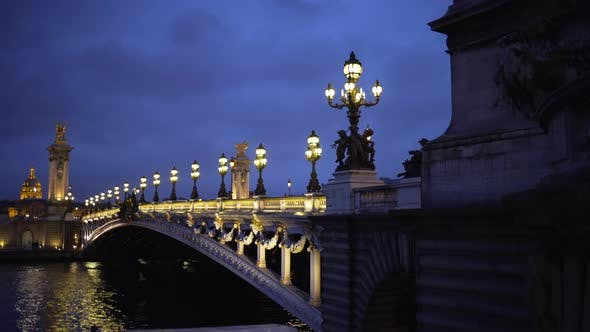 Thumbnail for Romantic scenery with lights and sculpture on historic French bridge in Paris