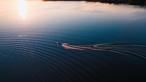 Motor boat on water at sunset