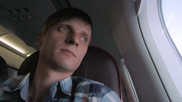 Thumbnail for Young Man In Plane Cabin