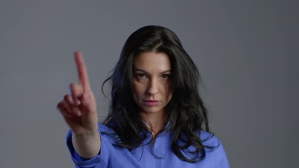 Adult Woman Disapproving with No Sign Make Negation Finger Gesture. Denying