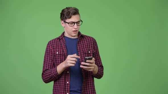 Thumbnail for Young Handsome Teenage Nerd Boy Using Phone