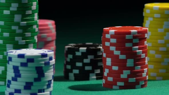 Thumbnail for Stacks of Colored Poker Chips on Green Casino Table, Red Dice Falling From Above