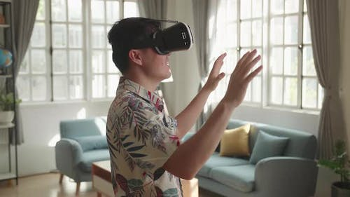 Man Wearing VR Headset And Explores At Living Room