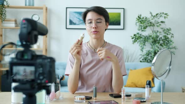 Cheeful Young Lady Recording Video About Visage Products Creating Content for Online Vlog
