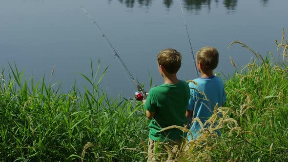 Two young boys fishing