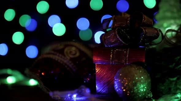 Thumbnail for Gift Box And Christmas Ball With Blinking Bokeh Lights