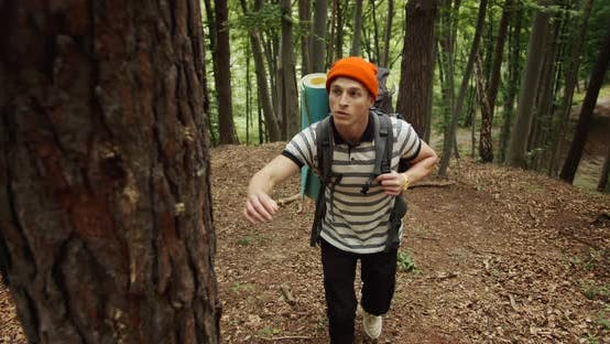 Thumbnail for Male Tourist Going Uphill in Forest