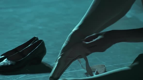 Thumbnail for Closeup of Ballerina Tying Ribbon on Foot Leg in Spotlight. Spbd Put on Pointe Shoes in Projector