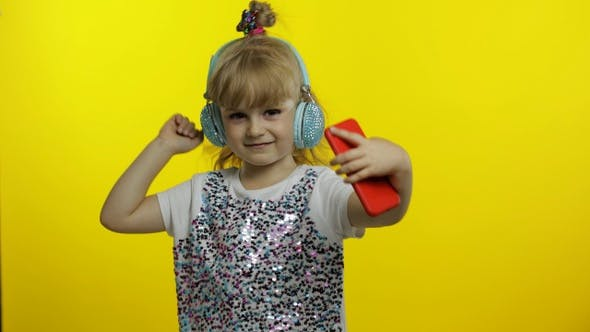 Thumbnail for Child Dances with Smartphone, Listening To Music on Headphones. Little Kid Girl Dancing, Having Hun