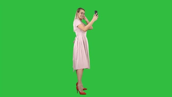 Thumbnail for Beautiful woman preen looking to her phone on a Green Screen