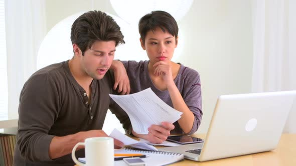 Thumbnail for Interracial couple figuring out their finances