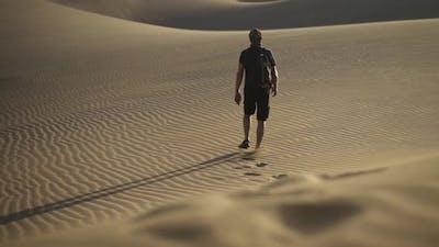 Footprints Of Man Walking In Desert