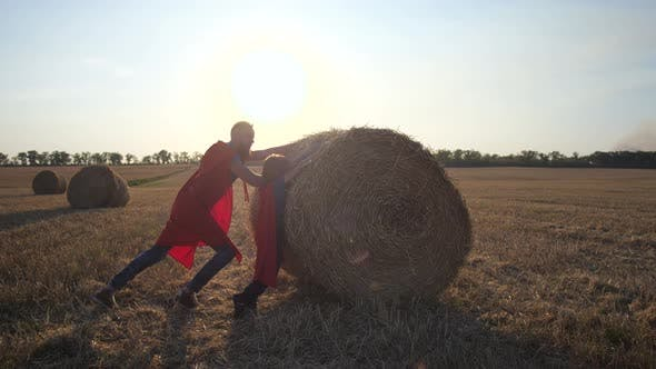 Thumbnail for Dad and Son As Strong Heroes Rolling Straw Stack