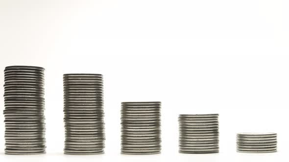 Thumbnail for Silver Coins on Stacks Are Decrease on White Background Stop Motion Animation