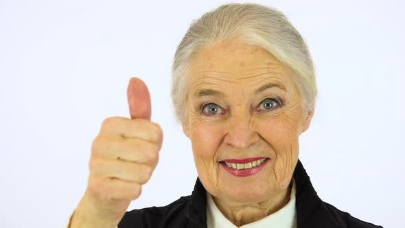 Thumbnail for An Elderly Woman Smiles and Shows a Thumb up To the Camera