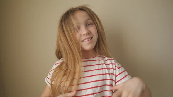 Thumbnail for Happy Small Blonde Girl Looking Into Camera Clapping Her Hands Indoor