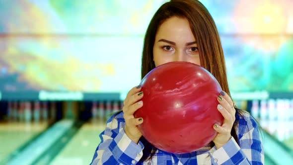 Thumbnail for Girl Looks Out From Behind the Bowling Ball