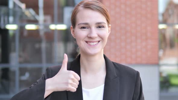Cover Image for Thumbs Up by Young Businesswoman, Outdoor