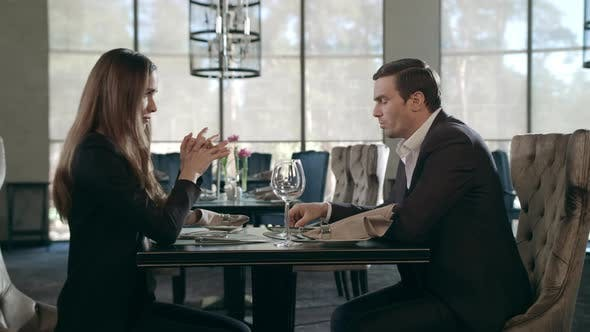 Thumbnail for Young Couple Meeting at Restaurant. Business Man and Woman Talking at Cafe Table