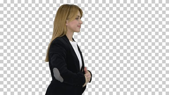 Blonde business woman walking and touching her hair, Alpha Channel